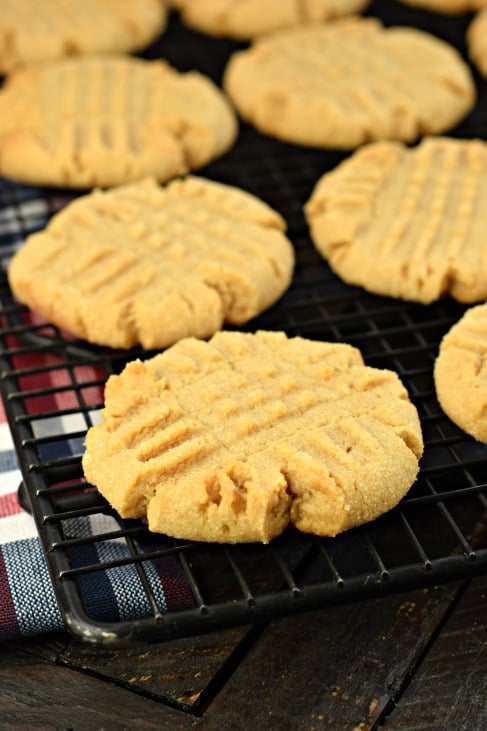 Peanut butter cookies on black wire rack