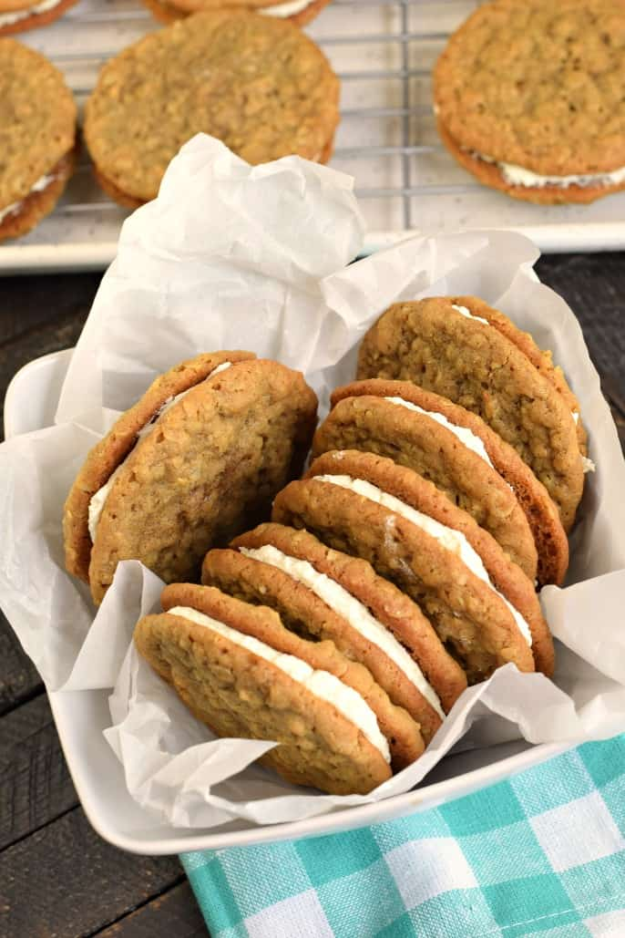 Bowl of oatmeal cream pies lined with parchment paper.