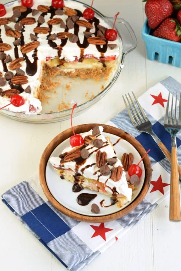 Easy Banana Split Cheesecake is the perfect summer dessert. Layers of graham cracker, cheesecake, pineapple, bananas, strawberries and all the sundae toppings!