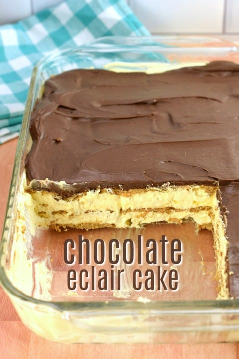 13x9 baking dish with chocolate eclair cake. Teal napkin in background.