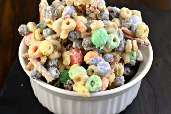 Easy WHITE TRASH CANDY recipe. For an easy treat, mix together cereal, pretzels, candy and melted white chocolate!