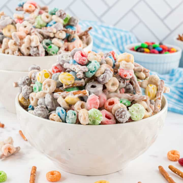 White trash candy mix in a white serving bowl.