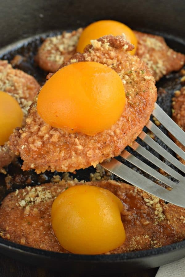 Breaded Pork Chops with Peach Glaze are the perfect copycat Shake and Bake dinner recipe, all topped with a juicy peach and glaze!