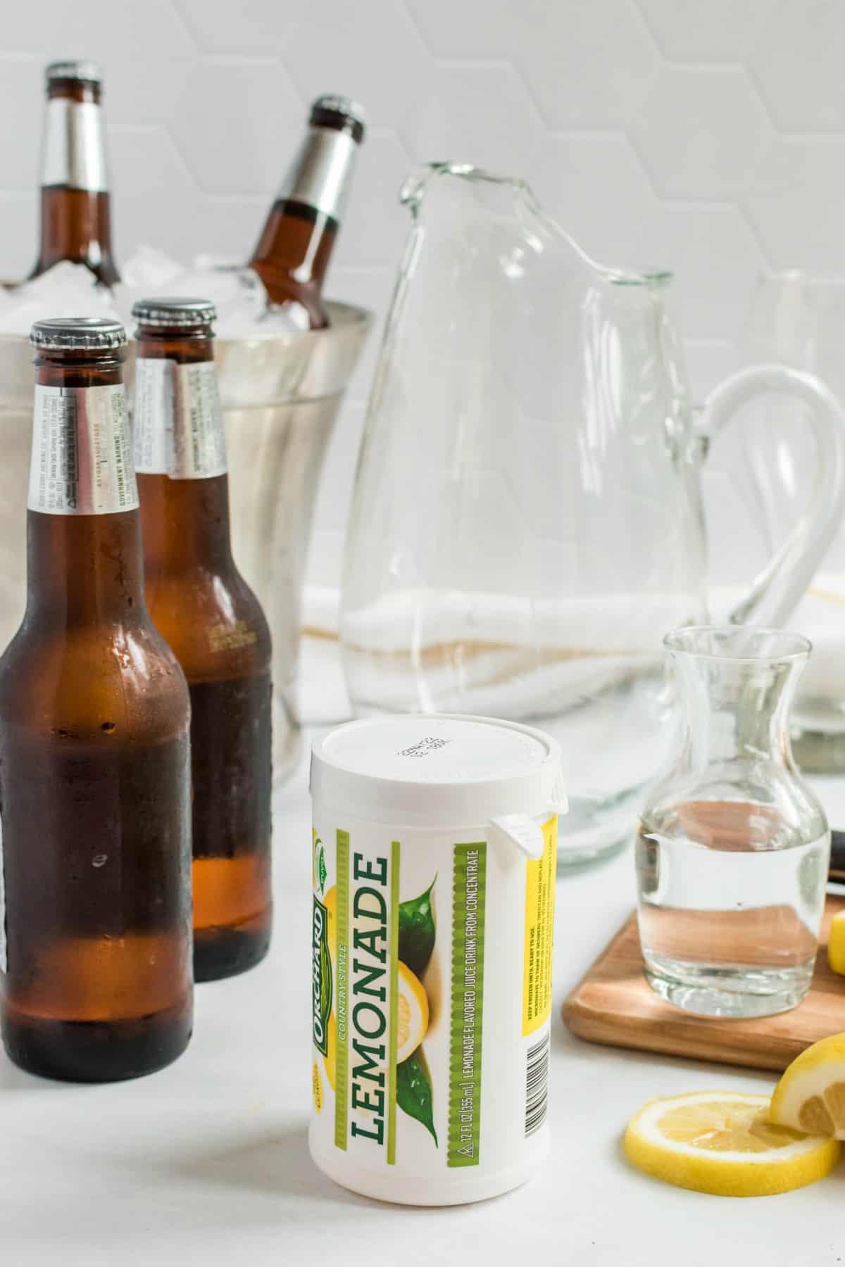 Ingredients needed for lemonade beer including beer, lemonade, and cherry rum.