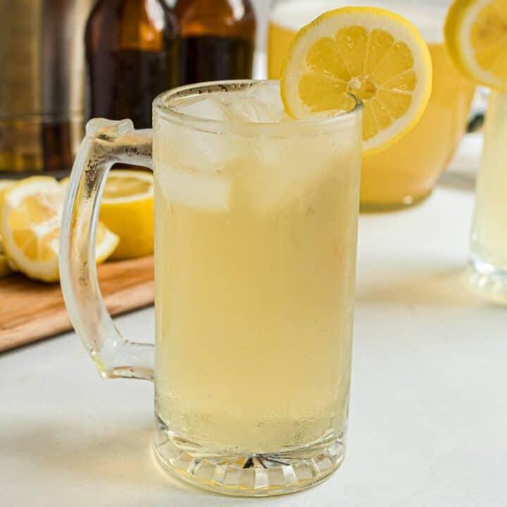 Beer mug filled with lemonade beer.