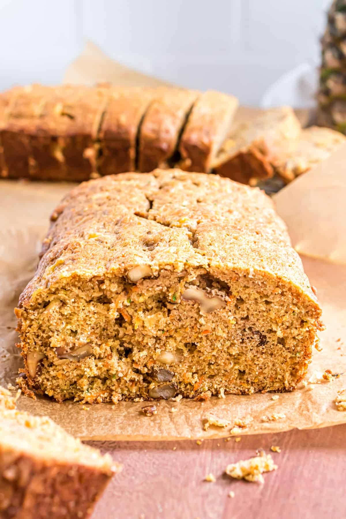 Loaf of zucchini bread with carrots and pineapple.