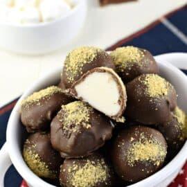 S'more truffles in a white bowl, one cut in half.