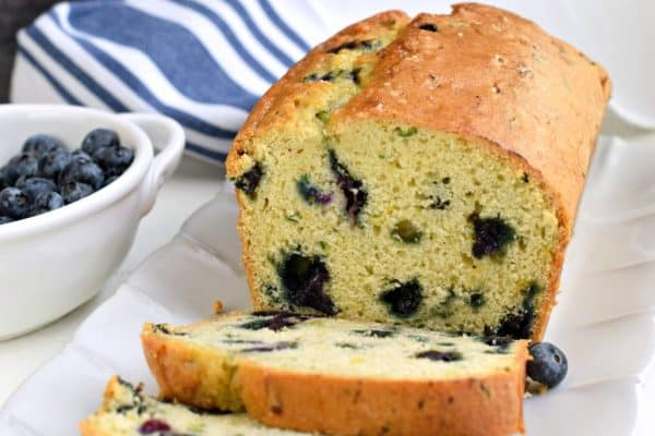 Make this fresh and delicious Zucchini Blueberry Bread recipe with your abundance of garden zucchinis this year. Freezer friendly recipe, bursting with flavor and color!