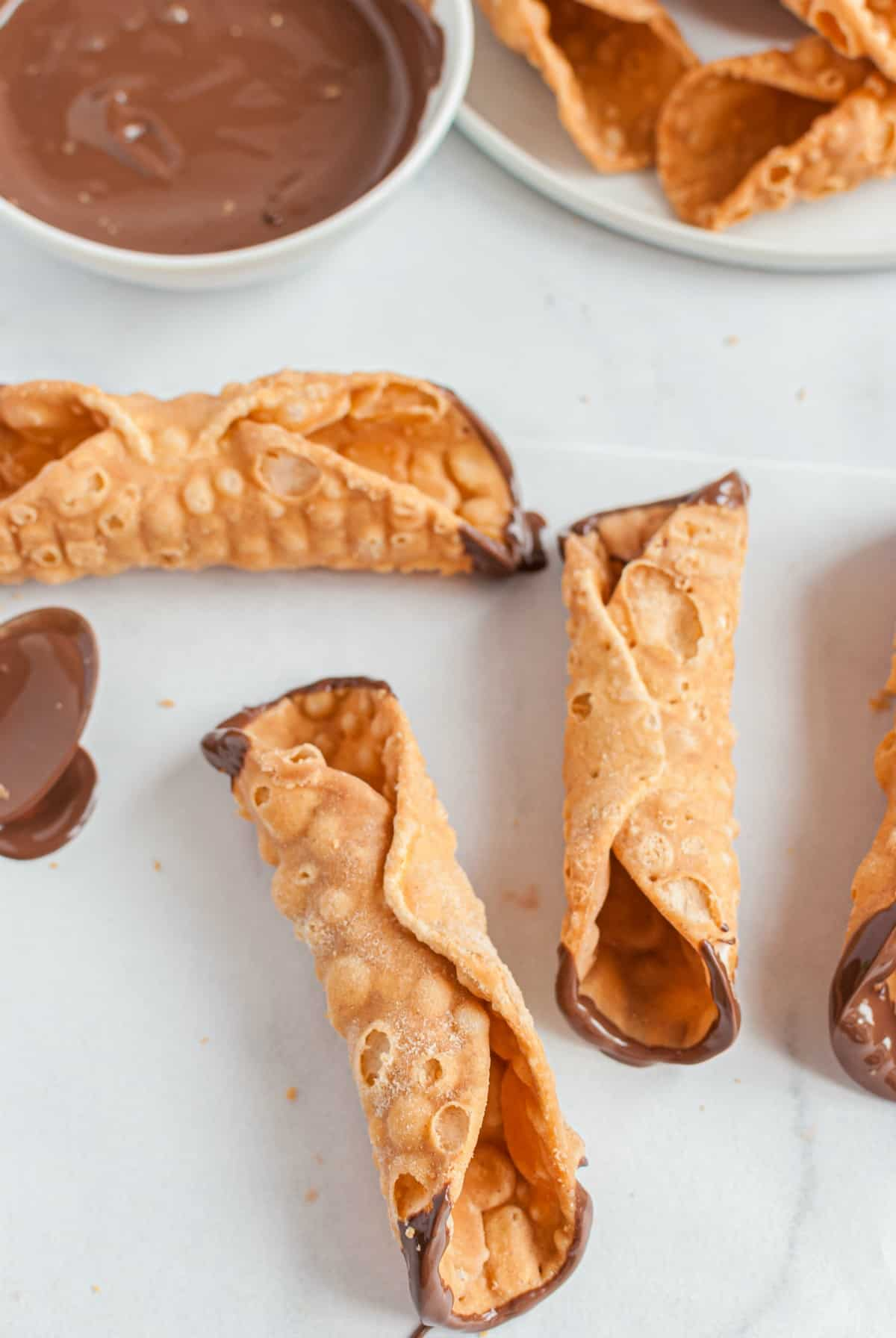 Cannoli shells dipped in chocolate.