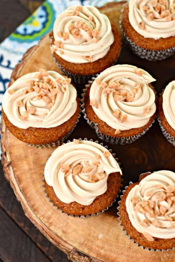 Incredibly moist Pumpkin Cupcakes with Maple and Toffee Frosting. You're going to love these award winning fall flavored cupcakes!