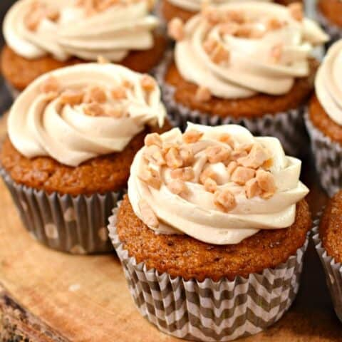 Pumpkin Cupcakes with cream cheese frosting and toffee bits.