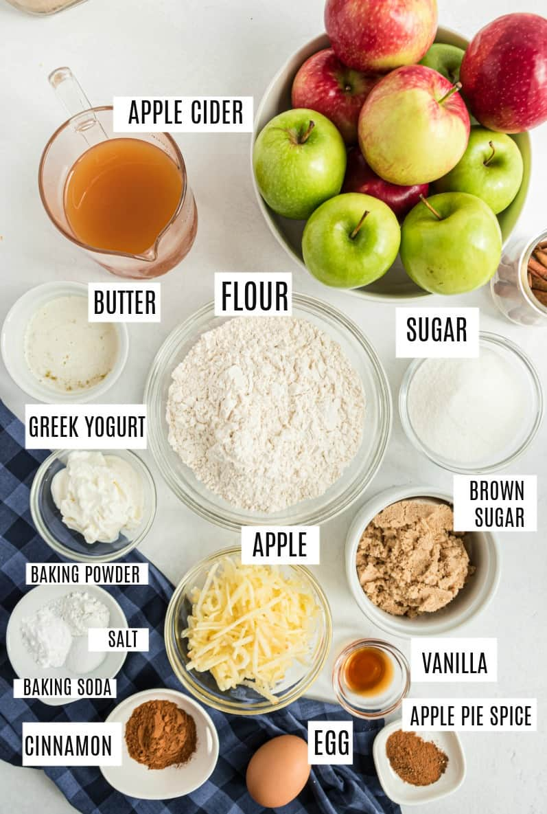 Ingredients needed to make apple cider donuts, including fresh apples, cider, and sugar.
