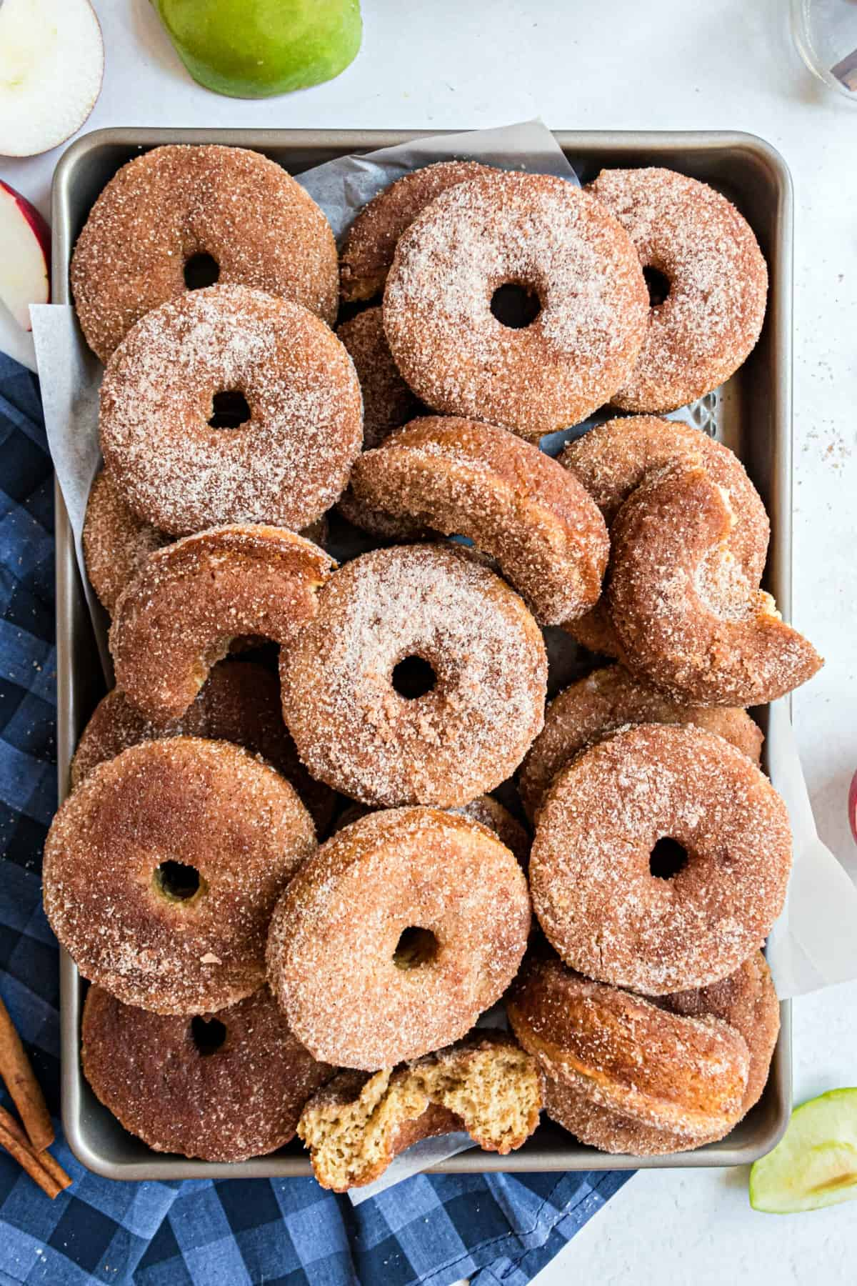 Baking sheet filled with apple cider donuts to serve.
