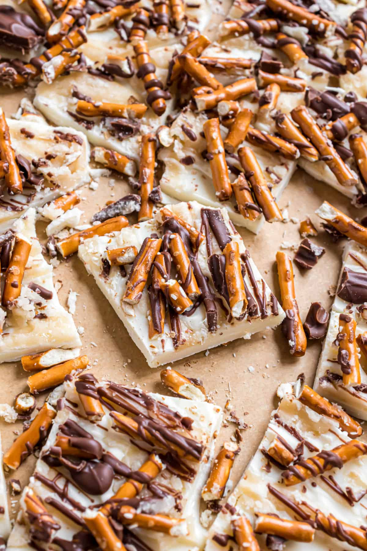 White chocolate topped with salted caramel, pretzels, and milk chocolate, cut into pieces.