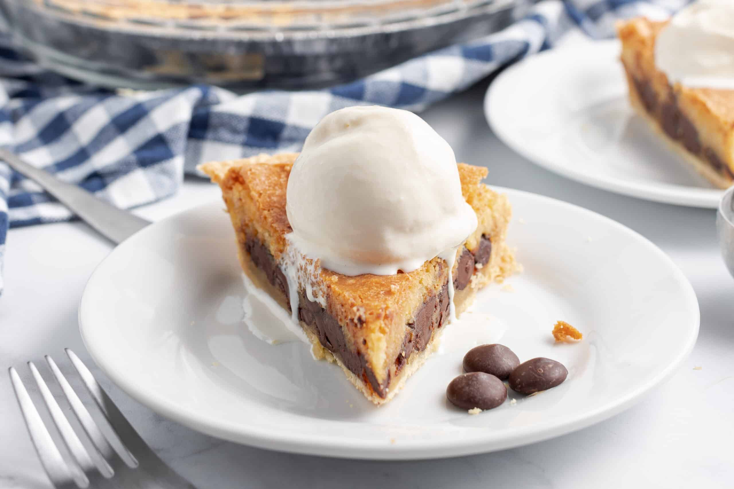 Pie with chocolate chip cookie dough baked in the filling topped with vanilla ice cream.