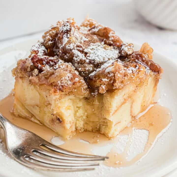 Slice of eggnog french toast with bite removed.