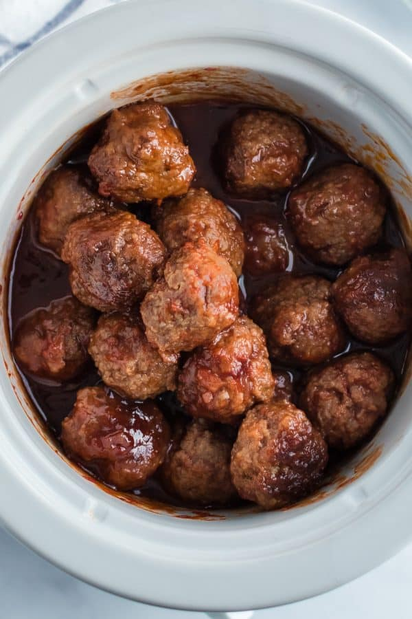Crockpot with grape jelly meatballs in sauce.