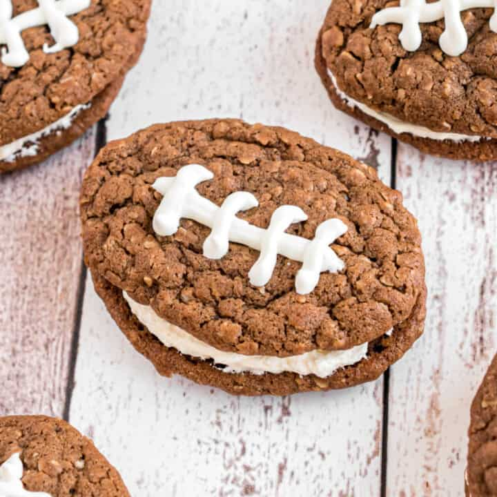 Football shaped chocolate oatmeal cream pies with white chocolate laces.