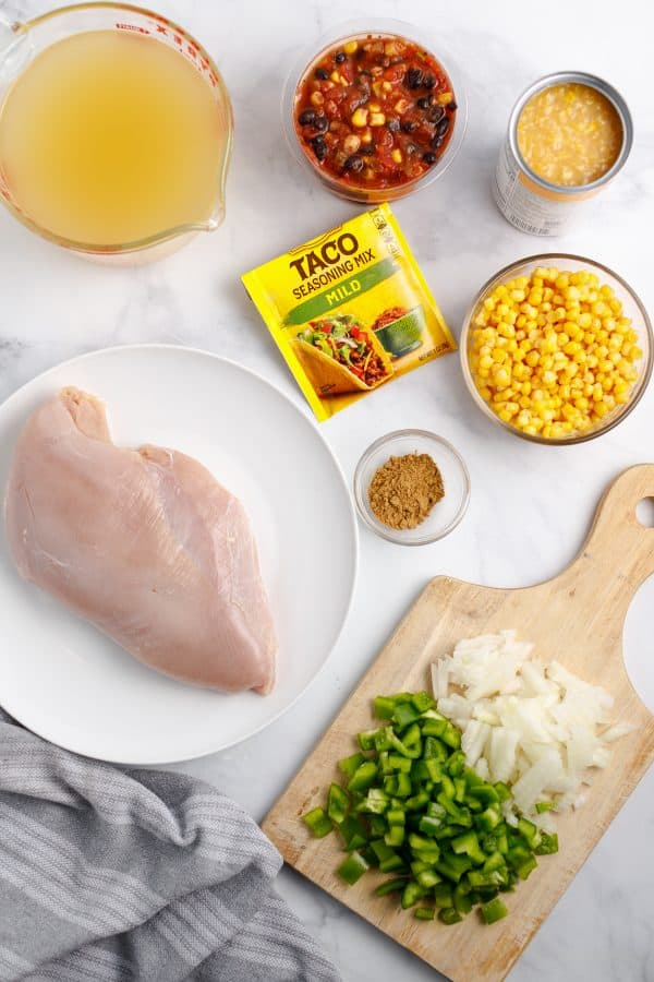 Ingredients for turkey taco soup: turkey, pepppers, onion, broth, salsa, corn, taco seasoning