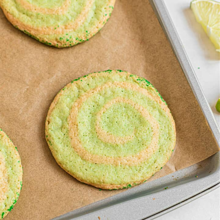 These Lime Swirled Icebox Cookies are here to add some zest to your sweet snacking! Flecked with green and kissed with lime flavor, Ice Box Cookies are a spring and summertime favorite.