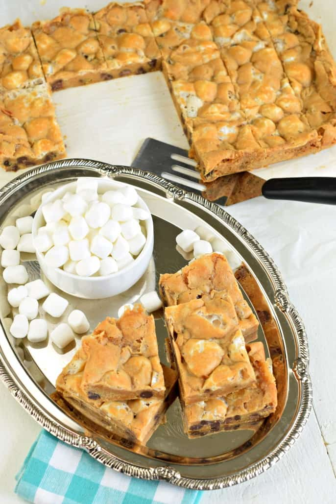 Chewy butterscotch bars on silver plate with mini marshmallows.
