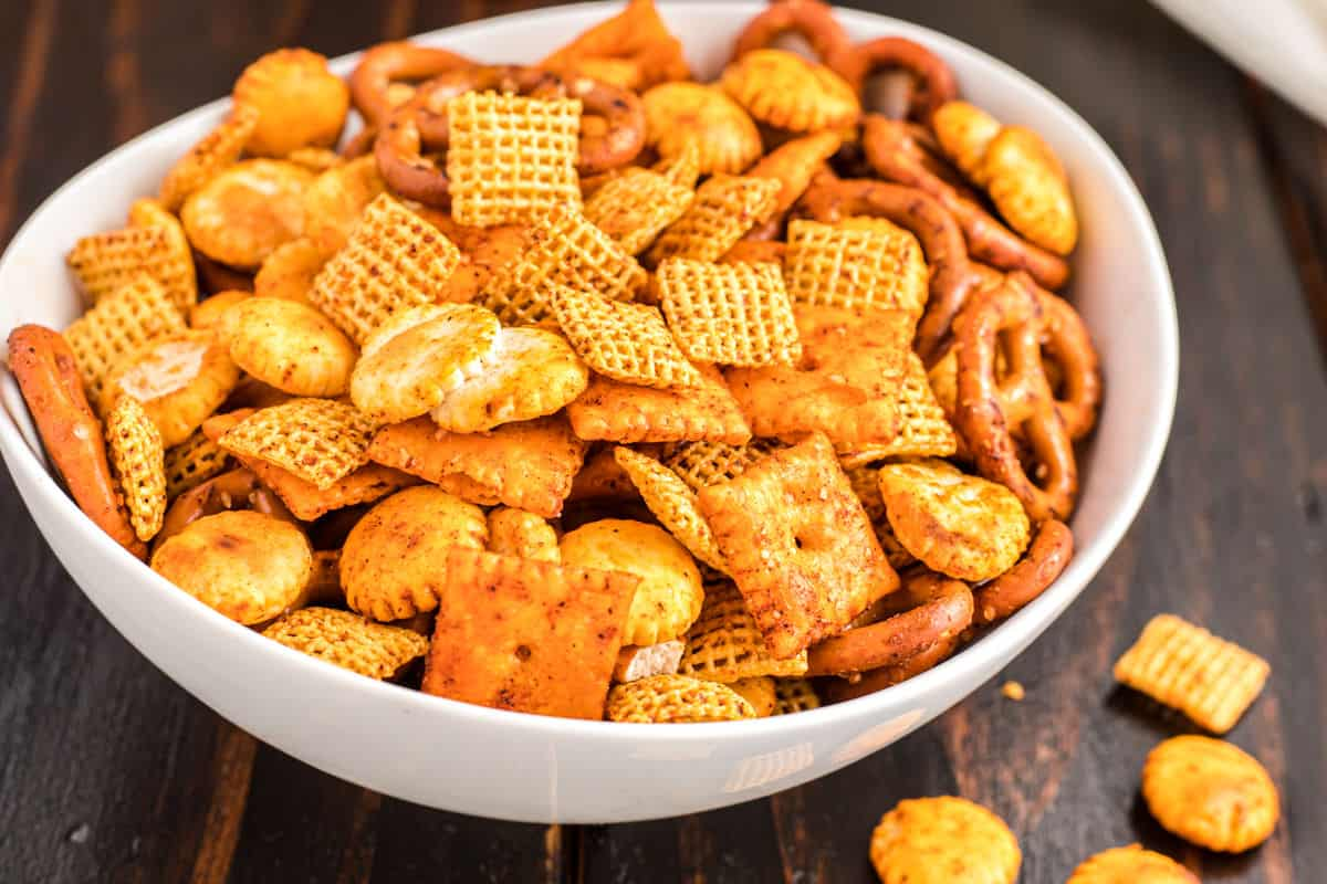 Taco chex mix in a white bowl.