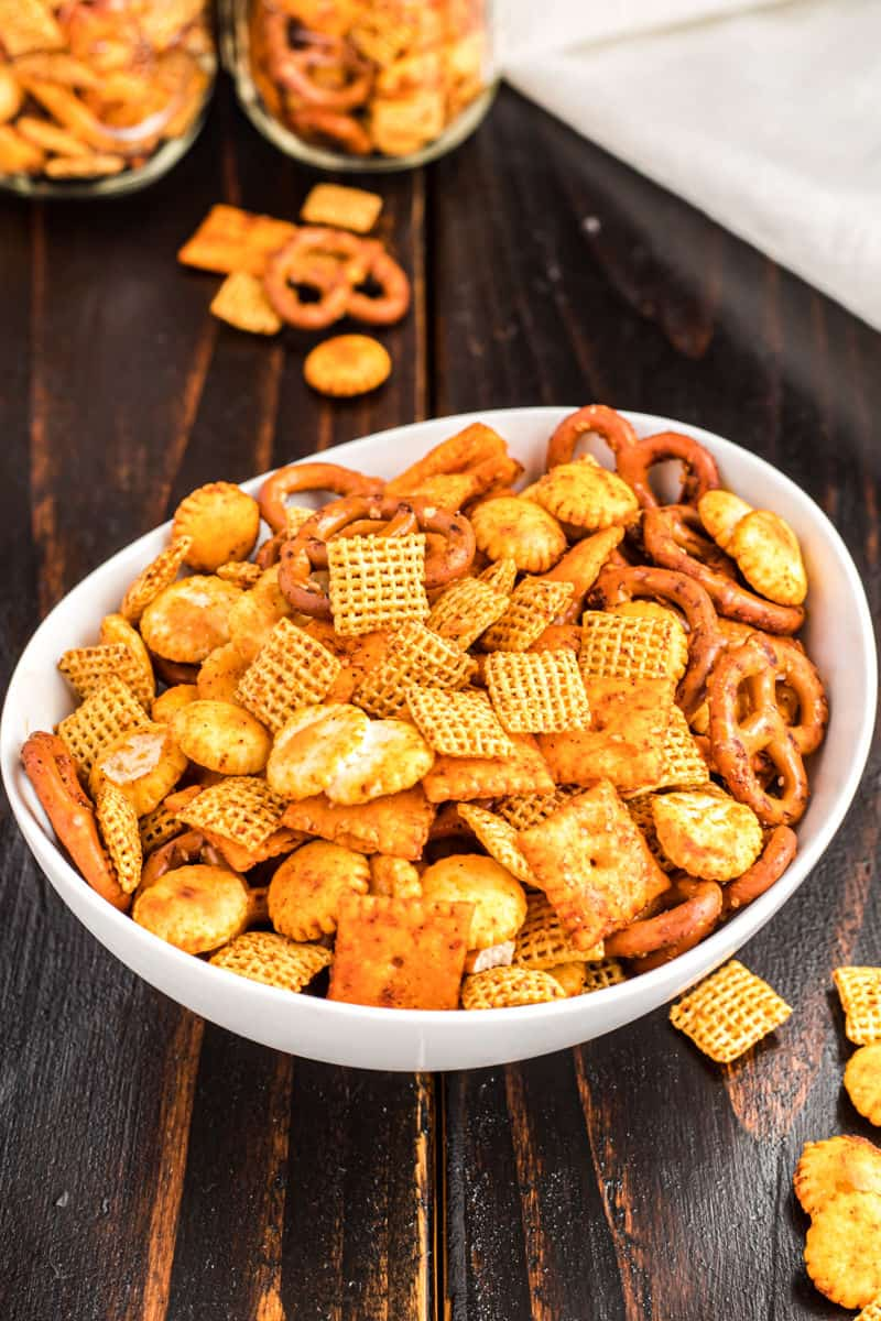 Spicy chex taco snack mix in a white bowl.