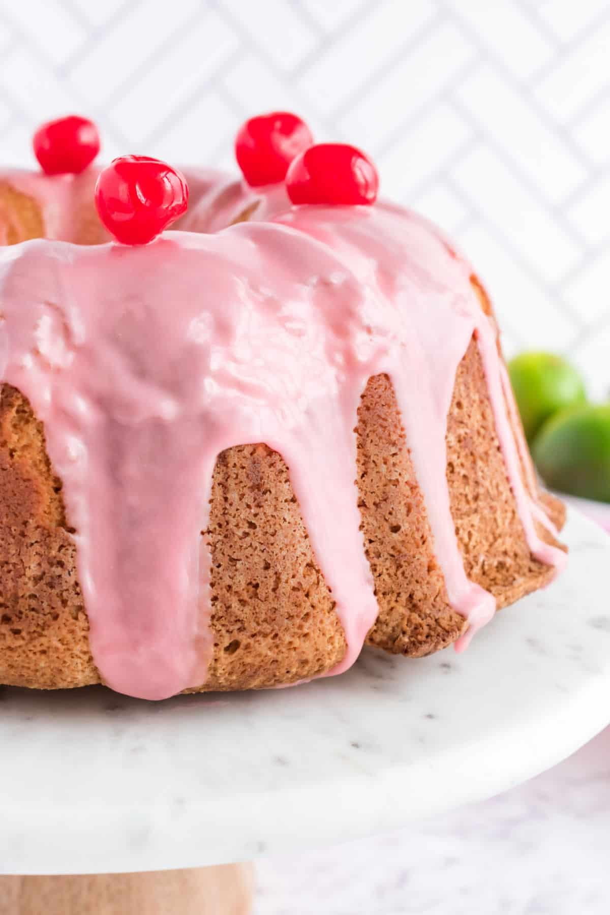 Cherry margarita pound cake on marble cake plate.