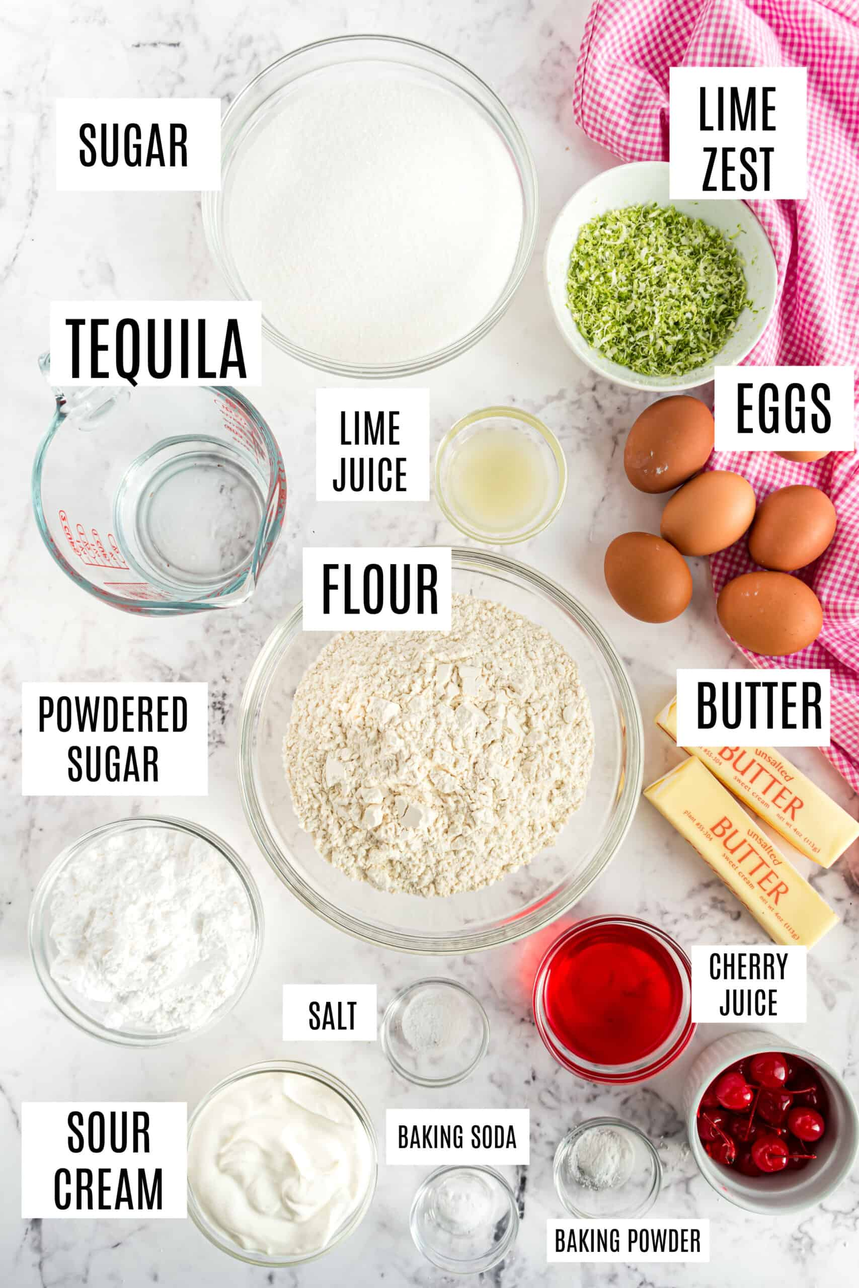 Ingredients needed to make cherry cake.