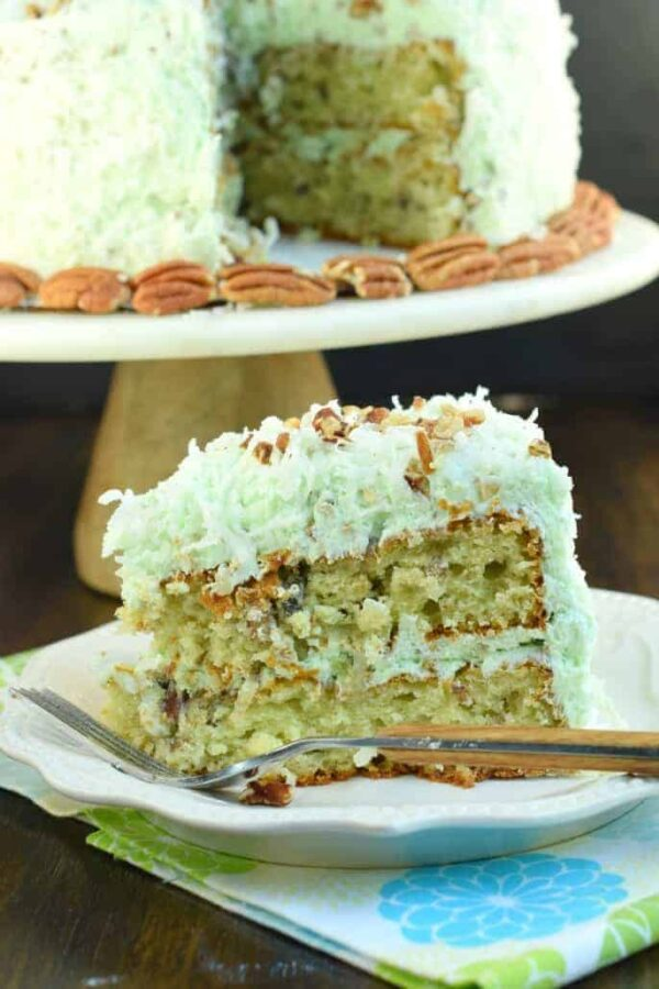 Watergate Cake: packed with flavor from pistachio pudding, coconut, pecans, and sweet frosting!