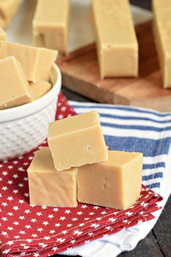 Peanut Butter Fudge stacked on red napkin with white stars