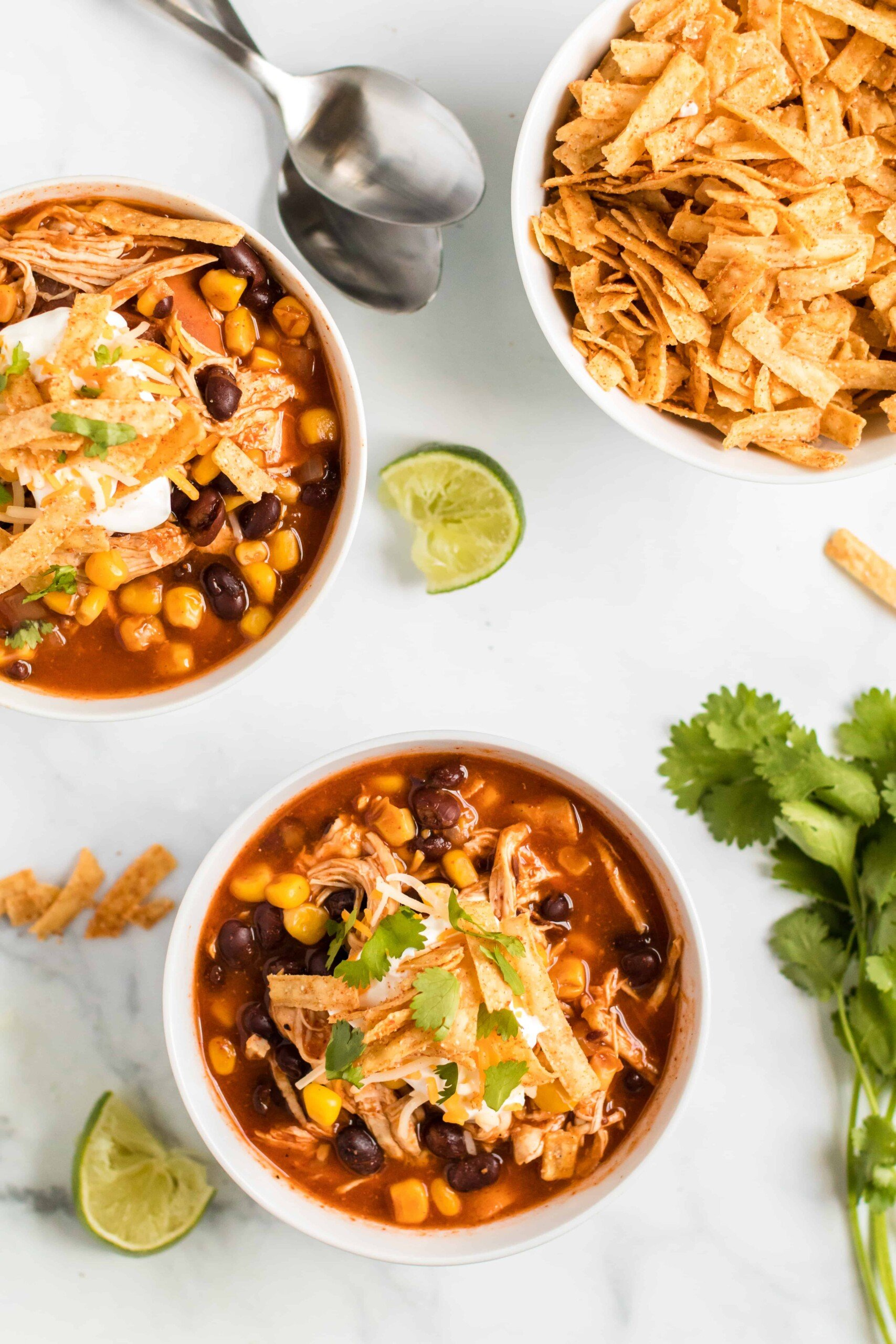 Two bowls of chicken enchilada soup.