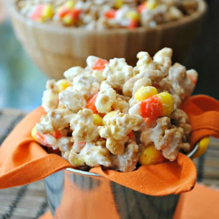 Homemade caramel corn with peanuts and candy corn to resemble a payday candy bar.