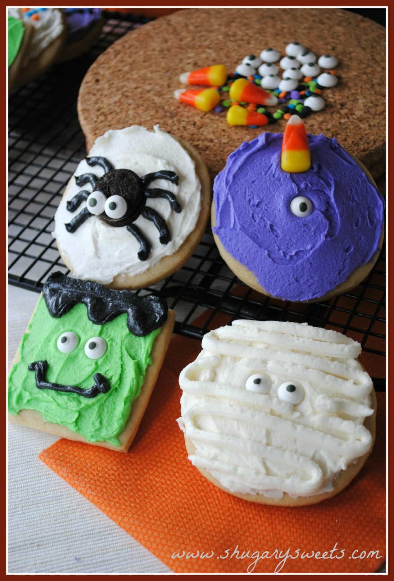 4 sugar cookies decorated like Halloween monsters.