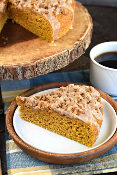 Pumpkin coffee cake with streusel on a white plate.