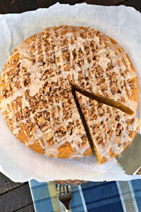 Pumpkin coffee cake with one slice being removed with pie server.
