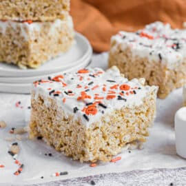 Rice krispie treat square with pumpkin spice and white chocolate.