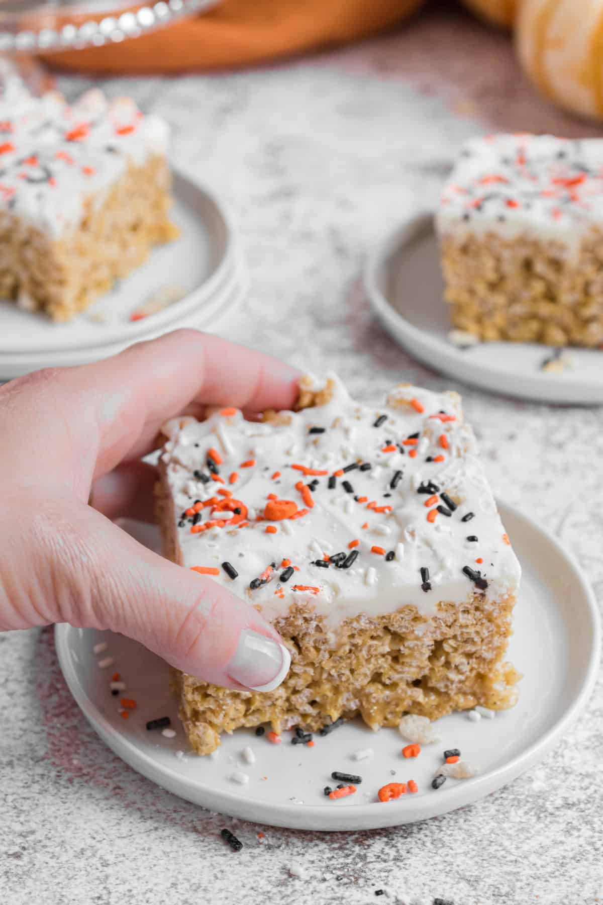 Rice krispie treat being lifted off plate.