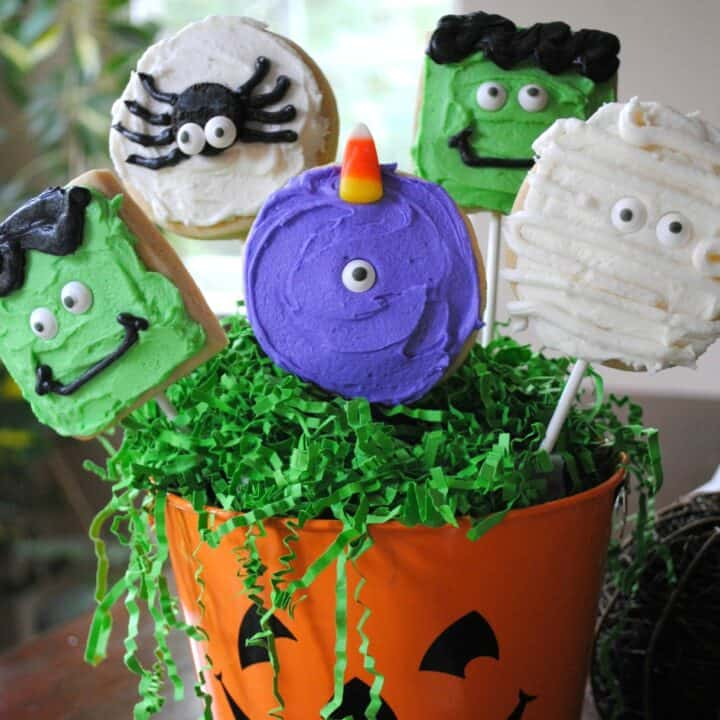 Bouquet of monster sugar cookies on lollipop sticks.