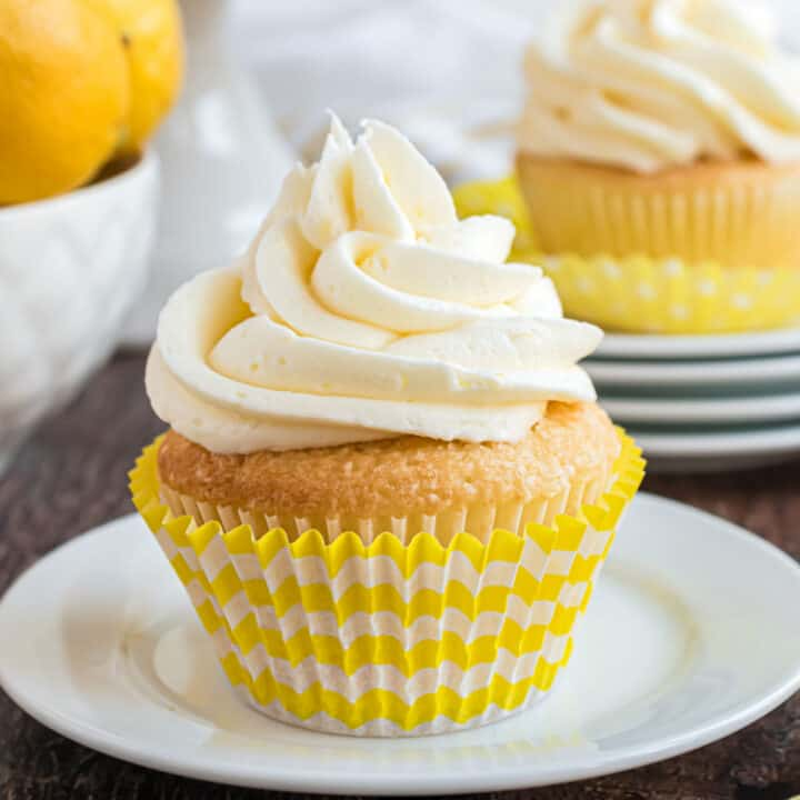 Lemon cupcake with high swirl of lemon frosting.