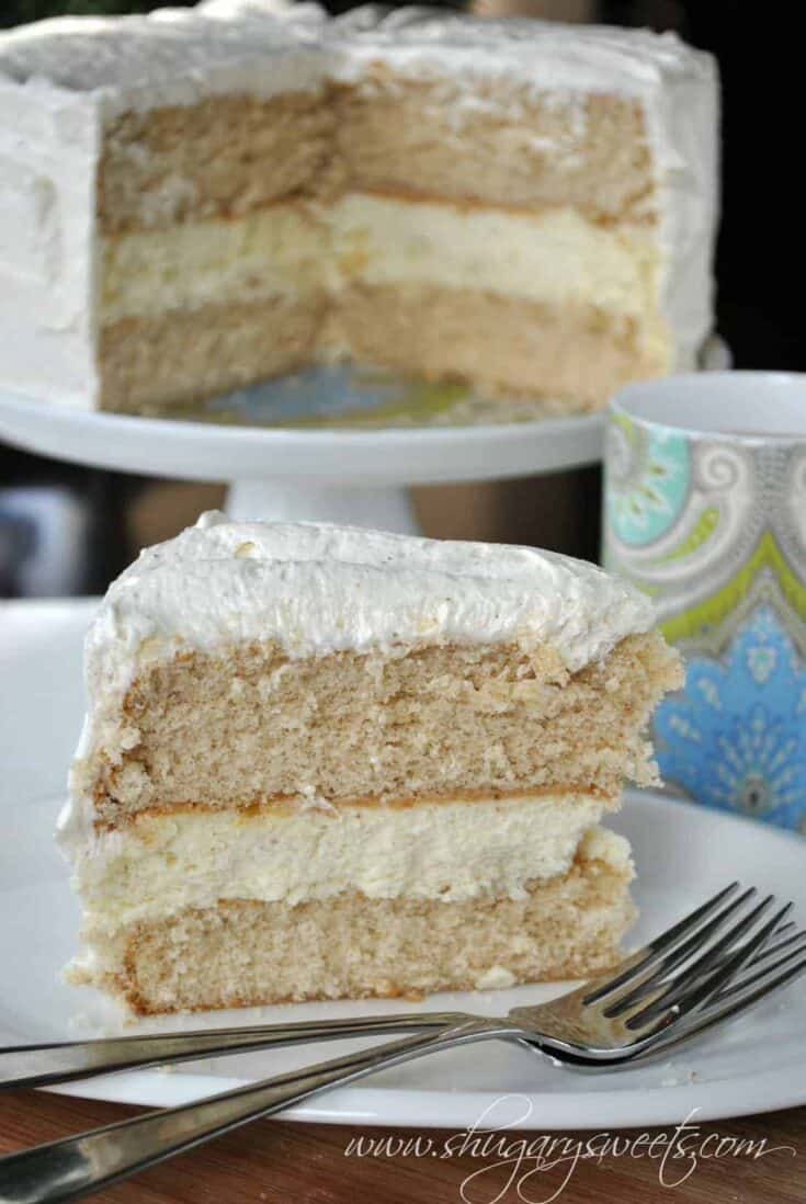 Layers of homemade spice cake with a creamy egg nog cheesecake filling and egg nog frosting!