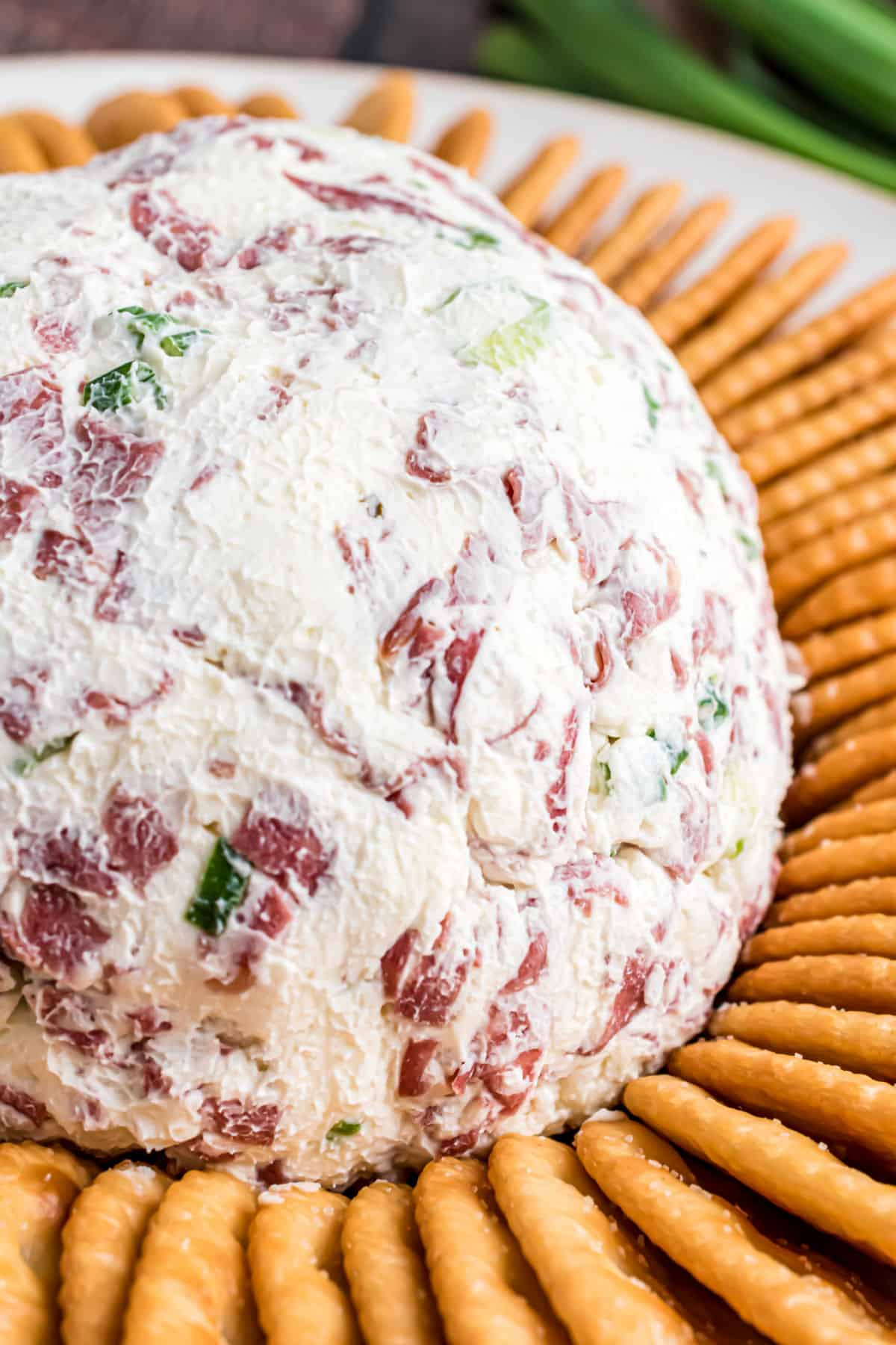 Chipped beef cheese ball served on a platter with buttery townhouse crackers.