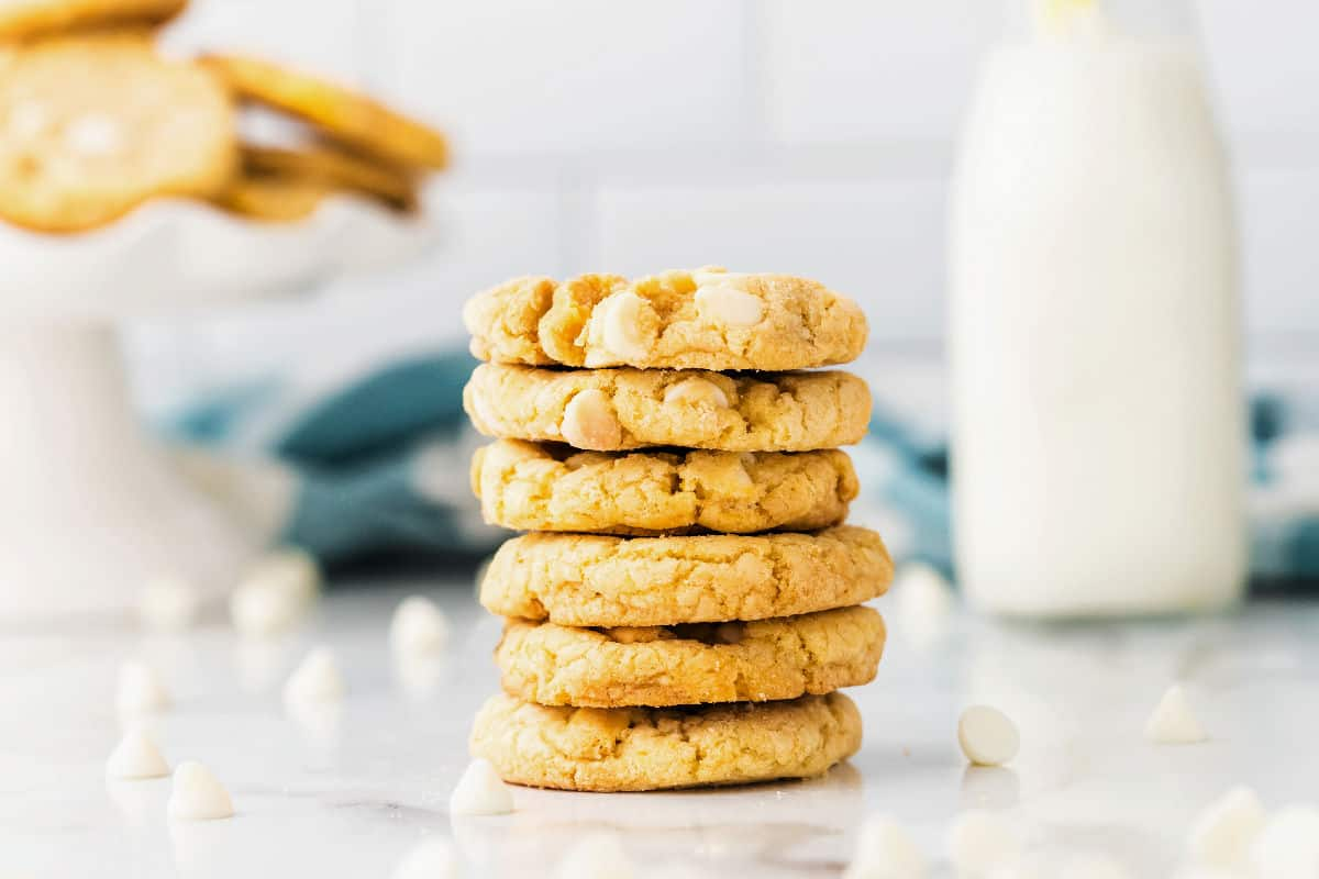 Lemon oreo cookies stacked on a counter.