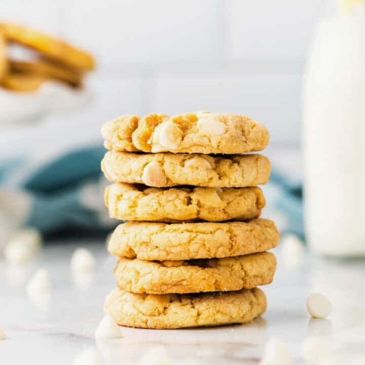 Delicious Lemon Cookies get a boost of extra crunch from lemon Oreos! Chewy lemon cookies with white chocolate chips, these are such a fun and easy treat to bake for family and friends!