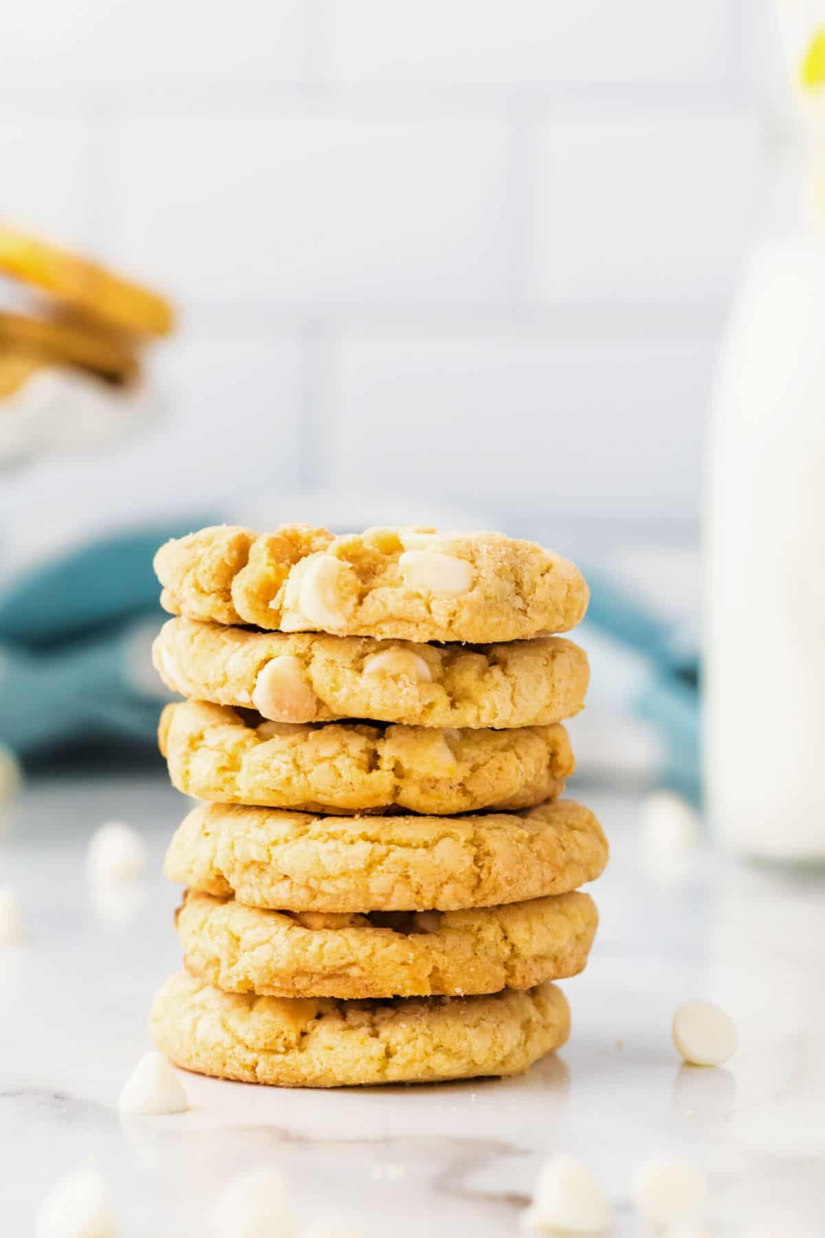 Stack of 6 lemon oreo crunch cookies on white counter.