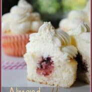 Almond Wedding Cake Cupcakes with Raspberry Filling- www.shugarysweets.com
