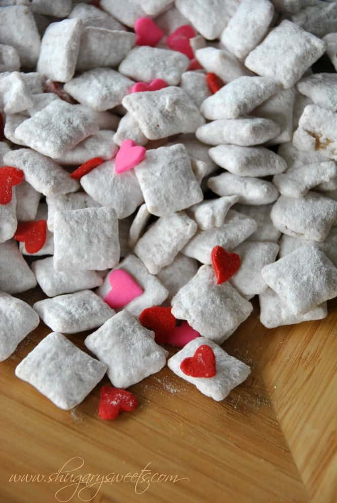 Cherry Vanilla Puppy Chow- easy, delicious puppy chow with cherry gelatin #valentines #puppychow www.shugarysweets.com