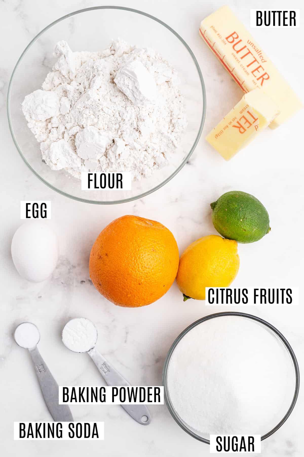 Ingredients needed to bake citrus flavored cookies.