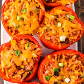 Stuffed red peppers with cheese and green onions.
