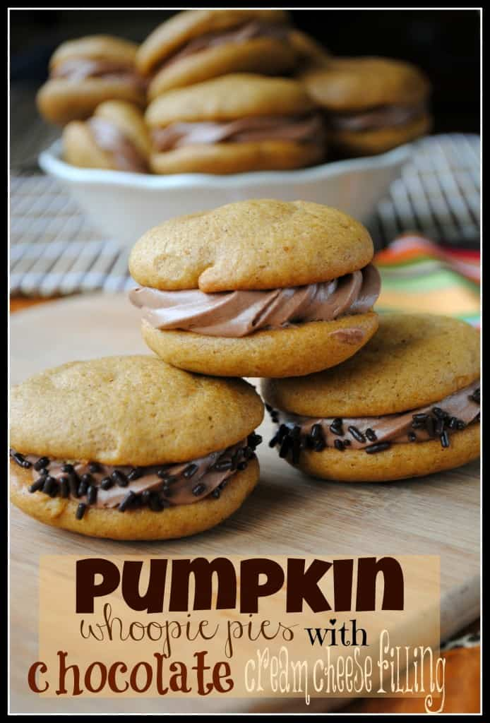 Pumpkin Whoopie Pies with Chocolate Cream Cheese Filling- so moist and delicious, you will crave these all year long #pumpkin www.shugarysweets.com